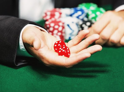 Gambling dices in the hand